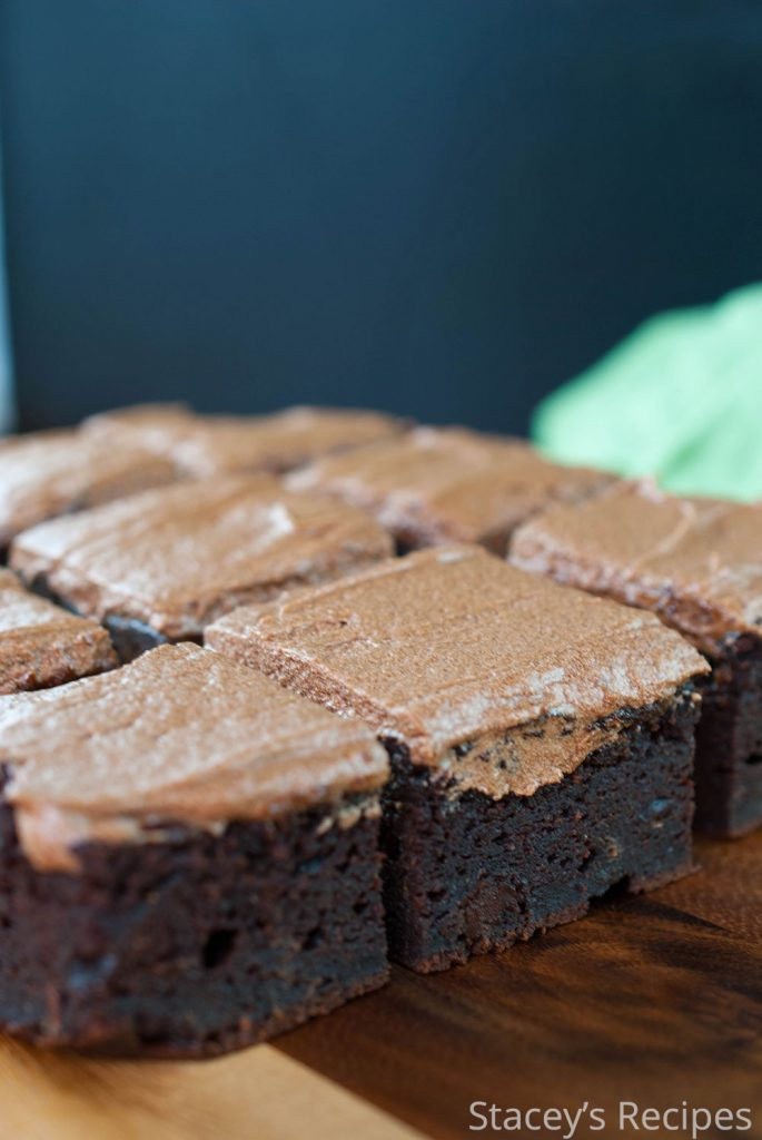 Treat yourself to these grain free, chocolately brownies packed with sweet potatoes and peanut butter. Smother them in a mocha frosting and enjoy! | https://www.staceysrecipes.com